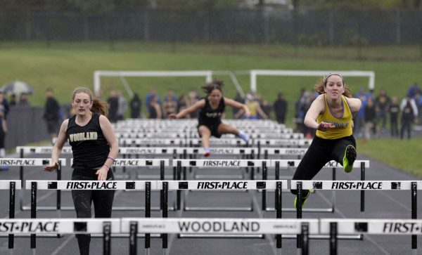 Beacon Falls, CT- 03 May 2016-050316CM11- Seymour's Madeline Lynch, right, clears a hurdle ahead of Woodland's Jordan Williams during the 100m hurdles in Beacon Falls on Tuesday. Lynch won the event. Christopher Massa Republican-American