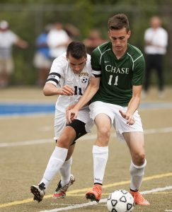 Kennedy's Mario Mikallari (11) and Chase's Justin Butler (11) battle for the ball during the annual city soccer jamboree Saturday at Municipal Stadium in Waterbury.  Jim Shannon Republican American