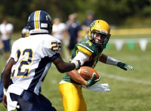 Holy Cross' Adam Razza tries to elude Kennedy's Zyier Allen during their NVL matchup in Waterbury on Saturday. Kennedy would go onto win, 36-21. Christopher Massa Republican-American