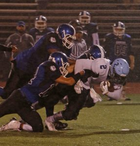 Waterbury, CT 093016MK07 Oxford's Joey Romagna drags a pile of Crosby defenders for extra yardage during NVL football action Friday night at Crosby High School.  Oxford defeated Crosby 9-0.  Michael Kabelka / Republican-American
