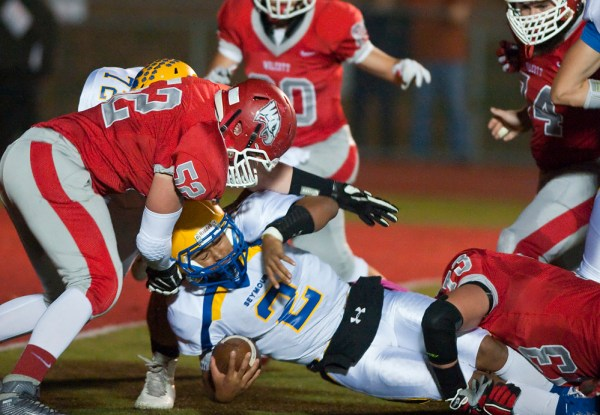 Seymour's Jaylen Kelley (2) gets stopped short of a first down by Wolcott's Philip Olmstead (52) and Cole Phelps (73) during their game Friday at Wolcott High School. Seymour defeated the Eagles 61-41. Jim Shannon Republican-American