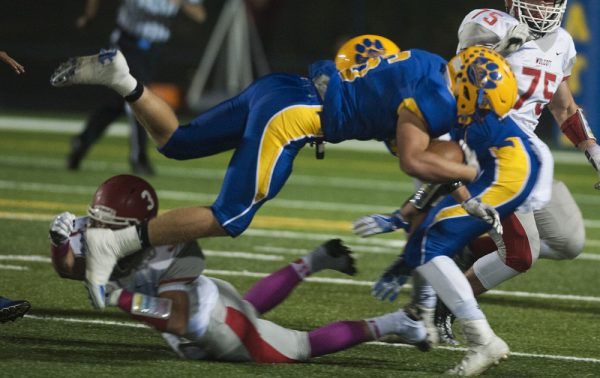 Seymour's Bobby Melms (6) gets upended by Wolcott's Nick Longo (3) during their game at Seymour High School. (Jim Shannon/RA)