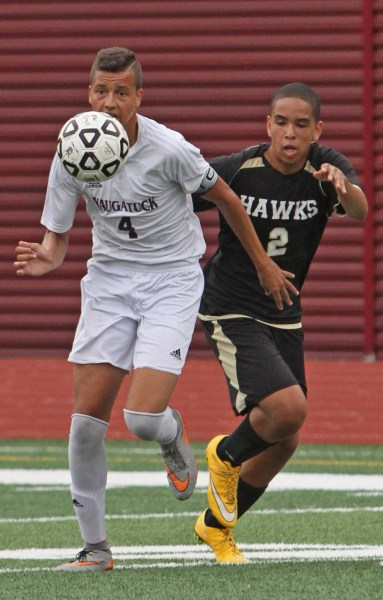 Naugy's Felipe Dutra races Woodland's Xavier Gibson for the ball during NVL action at Naugatuck High School Saturday afternoon. Naugatuck defeated Woodland 3-0. Michael Kabelka / Republican-American