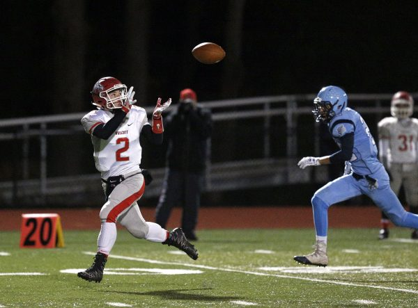 Wolcott's Anthony Ligi makes a catch ahead of Oxford's Noah Dargenio during their NVL matchup. Ligi would take the ball into the end zone for a touchdown. (Christopher Massa/RA)