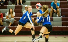 Lewis Mills' Anna Syzmanki, left, and teammate Alycia Forunier go in for the ball during their volleyball matchup against Naugatuck on Wednesday. Christopher Massa Republican-American