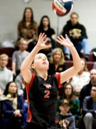Cheshire's Mia Juodaitis (2) sets the ball during their Class LL semi final game against Amity Wednesday at Naugatuck High School. Jim Shannon Republican-American