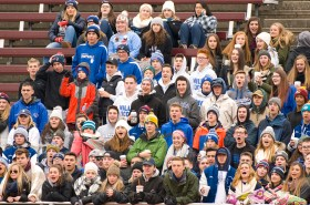 Lewis Mills' student body come out to cheer on their Spartans during their Class M state final game against Suffield Saturday at Willow Brook Park in New Britain. Jim Shannon Republican-American