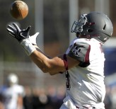 Naugatuck's Brandon Kuczenski, leaps up to make a catch during their Thanksgiving matchup against Ansonia Thursday morning in Ansonia. The Chargers were too tough for the Greyhounds, winning 48-27. Christopher Massa Republican-American