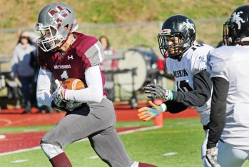 NaugatuckÕs Isaiah Williams (1) breaks free to score a touchdown on the final play of the first half as AnsoniaÕs Brent Washington (10) gives chase Thanksgiving morning at Naugatuck High School. Ansonia won the game, 46-28. Elio Gugliotti Republican-American