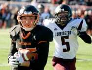 Watertown's Joseph Deptula (45) runs in a 49-yard touchdown reception in front of Torrington's Jacob Coleman (5) during their Thanksgiving Day game Thursday at Watertown High School. Jim Shannon Republican-American