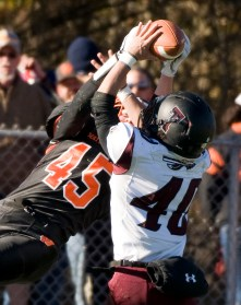 WATERTOWN, CT-112317JS08- Torrington's Starling Santos (40) breaks up a pass intended for Watertown's Joseph Deptula (45) during their Thanksgiving Day game Thursday at Watertown High School. Jim Shannon Republican-American