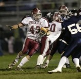 Naugatuck's Ryan Culbertson (43) looks for room against Ansonia during their Thanksgiving game at Ansonia Friday night. Jamison C. Bazinet Republican-American
