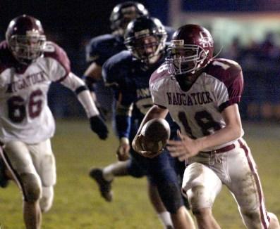 Naugatuck quarterback #18, Adam Katrenya, opts for the run against Ansonia at Jarvis Stadium in Ansonia Friday night. Todd Hougas photo