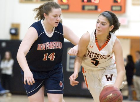 Watertown's Jordyn Forte (5) drives past New Fairfield's Grace Ware (14) during their non-league game Thursday at Watertown High School. Jim Shannon Republican-American