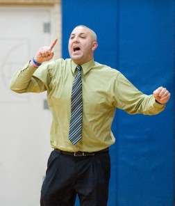 Kaynor Tech head coach Brian Stasaitis yells out instructions to his players during their game against Wolcott Tech Thursday at Wolcott Tech school in Torrington. Jim Shannon Republican-American