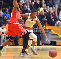 Sacred Heart's Andre Anderson drives around Wilbur Cross' Jaykeen Foreman (4) during their Division I quarterfinal game Monday at Wilby High School in Waterbury. Jim Shannon Republican-American