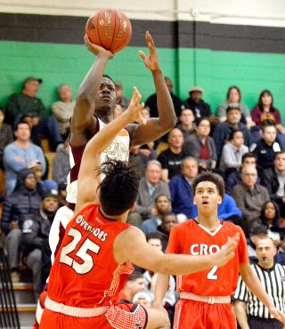 Sacred Heart's Raheem Solomon (11) puts up a shot over Wilbur Cross' Jose Feliciano Vega (25) during their Division I quarterfinal game Monday at Wilby High School in Waterbury. Jim Shannon Republican-American