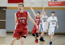 Wamogo's Garrett Sattazahn (12) and Ethan Collins (11) celebrate their 64-57 win over East Hampton in the Division V semifinal game Wednesday at Wolcott High School. Jim Shannon Republican-American