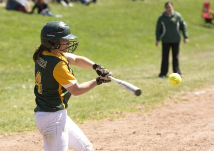 WATERBURY, CT-042118JS13- Holy Cross Lizzy Diorio (14) blasts a three RBI triple during their game against Seymour Saturday at Holy Cross High School. Jim Shannon Republican American