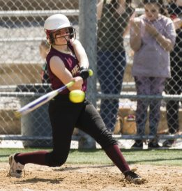 WATERBURY, CT-042818JS12- Sacred Heart's Kayleigh O'Donnell (5) rips a two-run home run during their game against Kennedy Saturday at Kennedy High School. Jim Shannon Republican American