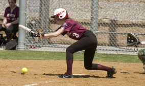 WATERBURY, CT-042818JS20- Sacred Heart's Lauren Kiluk (3) lays down a bunt to load the bases during their game against Kennedy Saturday at Kennedy High School. Jim Shannon Republican American