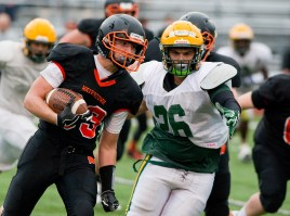 Watertown's Anthony Velardi (33) cuts to the outside during their pre-season scrimmage against New London Friday at Watertown High School. Jim Shannon Republican American
