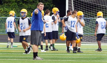 2017: Seymour High School head football coach, Tom Lennon, runs his players through drills during football practice at the school. (RA)