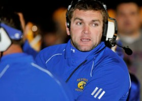 2009: Seymour's first year head coach Tom Lennon talks with his players during their game against Naugatuck. (RA)
