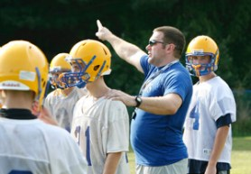 2009: Seymour High School football head coach Tom Lennon instructs his team during practice. (RA)