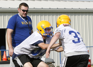 2009: Seymour High School football head coach Tom Lennon watches a drill during practice. (RA)