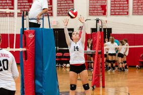 Julia Vanderlaan of Pomperaug sets the ball for a teammate as Pomperaug hosts Seymour in a girls volleyball scrimmage at Pomperaug High School in Southbury on Monday afternoon. Bill Shettle Republican-American