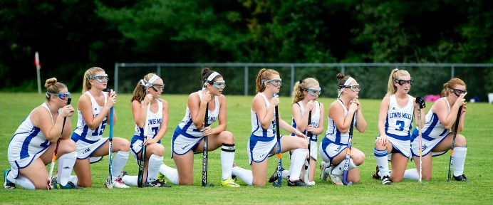 Lewis Mills players look on as teammate Kaleigh Soucy (8) takes a penalty shot during their Berkshire League game against Northwestern Tuesday at Lewis S. Mills High School in Burlington. Jim Shannon Republican American