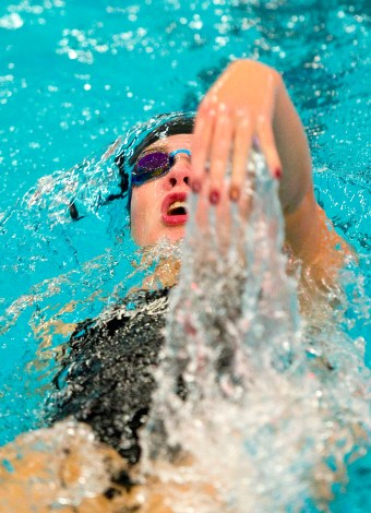 Pomperaug's Celia Brown competes in the 100M backstroke during their meet against Stratford in SWC swim action Tuesday at Pomperaug High School. Jim Shannon Republican American