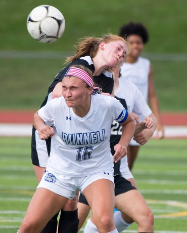 Bunnell's Holy Rosa (16) and Pomperaug's Holly McFarland (14) battle for position as they both go for the ball during their game Saturday at Pomperaug High School. Jim Shannon Republican American