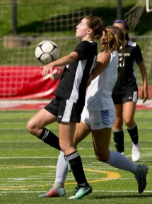 Pomperaug's Kate Johnson (19) settles the ball in front of Bunnell's Samantha Crowther (1) during their game Saturday at Pomperaug High School. Jim Shannon Republican American