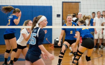 Seymour's Megan Condo (2) celebrates a point with her teammates during their match against Oxford Tuesday at Seymour High School. Jim Shannon Republican American