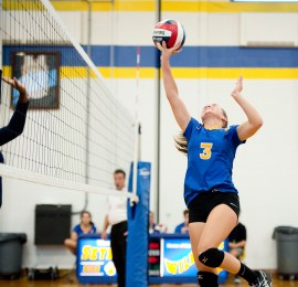 Seymour's Alyssa Cosciello (3) tips the ball over the net during their match against Oxford Tuesday at Seymour High School. Jim Shannon Republican American