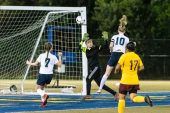 Oxford's Molly Sastram #10 goes high to head the ball past Sacred Heart's Goalkeeper Victoria Creaven to score a goal during the NVL Girls Soccer Game between Oxford and Sacred Heart at Municipal Stadium in Waterbury on Wednesday. Bill Shettle Republican-American