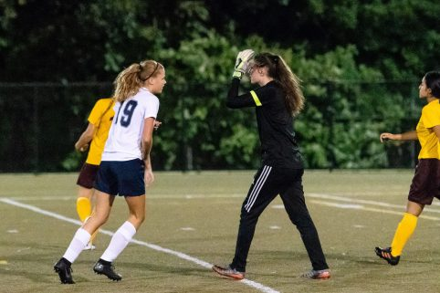 Sacred Heart Goalkeeper Victoria Creaven, right, reacts after Oxford's Abby Remond scores a goal past her during the NVL Girls Soccer Game between Oxford and Sacred Heart at Municipal Stadium in Waterbury on Wednesday. Bill Shettle Republican-American