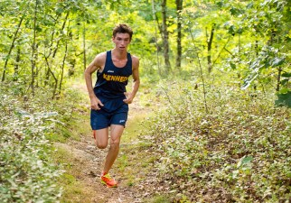 Kennedy's Alex Brites makes his way through the woods during their meet with Holy Cross, Torrington and Wilby, Wednesday at Holy Cross High School in Waterbury. Jim Shannon Republican American