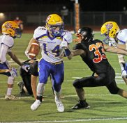 Seymour's Jacob Carfo (14) rushes past Watertown's Anthony Velardi (#33) during NVL action Friday at Watertown High School. Michael Kabelka / Republican-American