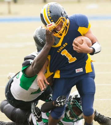 Kennedy's Matt Torres (1) gets brought down by the face mask during their game against Wilby Saturday at Municipal Stadium in Waterbury. Jim Shannon Republican American