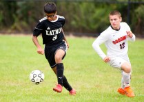 Kaynor Tech's Zachary Persaud (9) slips past Goodwin Tech's Hunter Holley (12) during their game Monday at Kaynor Tech High School in Waterbury. Jim Shannon Republican American