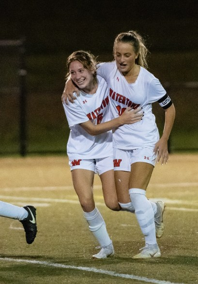 Watertown's Meadow Mancini #10 right, celebrates with teammate Malina LaCapra #6 after scoring a goal during a NVL Girls Soccer game between Watertown and Holy Cross at Municipal Stadium in Waterbury on Wednesday. Watertown won 2-0, scoring two second half goals. Bill Shettle Republican-American