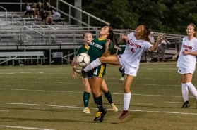 Watertown's Elaina Vilar #4 gets the ball first in front of Holy Cross defender Delia Murphy #11 during a NVL Girls Soccer game between Watertown and Holy Cross at Municipal Stadium in Waterbury on Wednesday. Watertown won 2-0, scoring two second half goals. Bill Shettle Republican-American