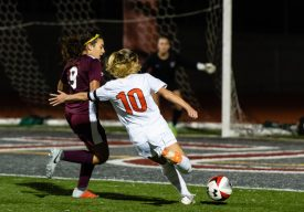Watertown's Meadow Mancini #10 takes a shot on goal with Naugatuck's Sophia Marques #9 defending during a Girls NVL Soccer game between Watertown and Naugatuck at Naugatuck High School in Naugatuck on Monday. Bill Shettle Republican-American