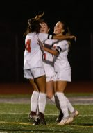 Watertown's Meadow Mancini #10, right celebrates her goal with teammates Elaina Vilar #4, left and Morgan Dodge #11, center during a Girls NVL Soccer game between Watertown and Naugatuck at Naugatuck High School in Naugatuck on Monday. Bill Shettle Republican-American