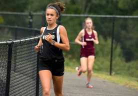 Woodland's Jayden Found finished third during their cross country meet with Derby, Kennedy and Sacred Heart Tuesday at Woodland Regional High School in Beacon Falls. Jim Shannon Republican American