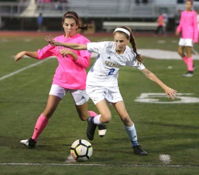 Seymour High School's Kathrine Bruno battles Wolcott High School's Samantha Riviezzo for the ball during the girls varsity soccer game in Wolcott on Thursday. Emily J. Reynolds. Republican-American