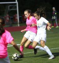 Wolcott High School's Michaela Vaughn battles Seymour High School's Victoria Bibekaj for the ball during the girls varsity soccer game in Wolcott on Thursday. Emily J. Reynolds. Republican-American